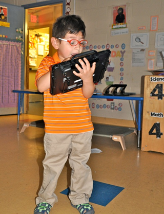 Mikey in June 2017 with his speech generating device!